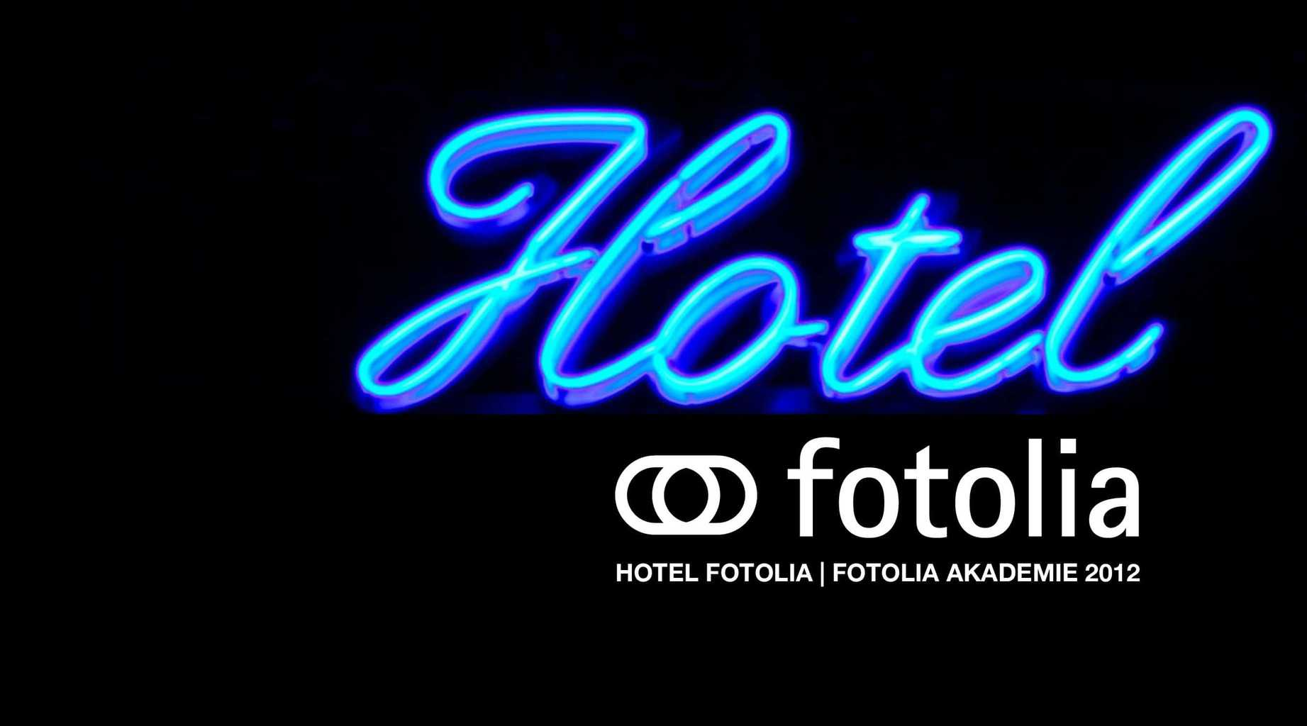 Neon sign, Hotel. Flashes of blue and green.